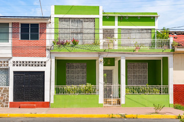 Facade of colorful houses in the historic district Granada in Nicaragua