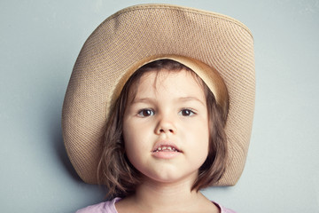 Child in cowboy hat