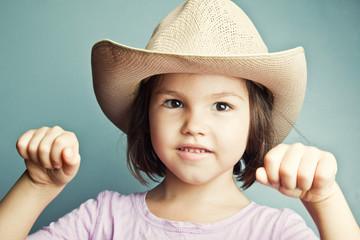 Child in cowboy hat