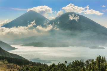 Landscape of volcanoes surrounding lake Atitlan in Guatemala.