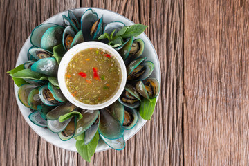 Steamed mussels with spicy sauce, Thai food.