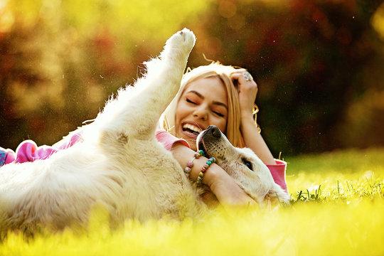 Woman enjoying park with dog