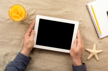 Male hands holding tablet with copy space