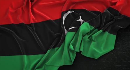 Libya Flag Wrinkled On Dark Background 3D Render