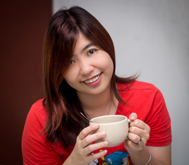 Beautiful Young Asian - Chinese Woman Holding Cup