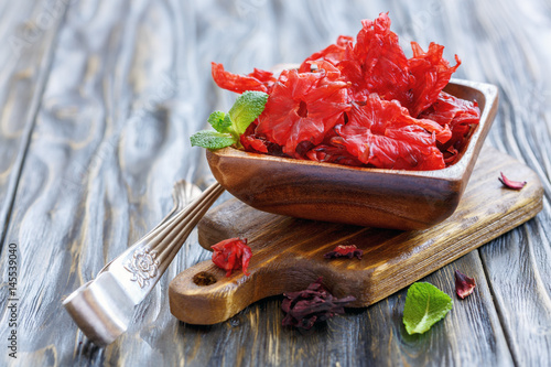 Candied Hibiscus Flower And A Sprig Of Mint In A Bowl Stock Photo