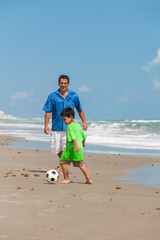 Father Parent Boy Child Playing Soccer Football on Beach