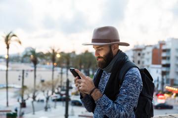 Male traveler using phone