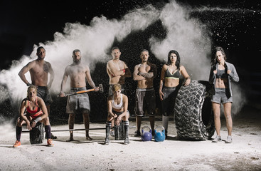 Group of athlete posing with sport equipment