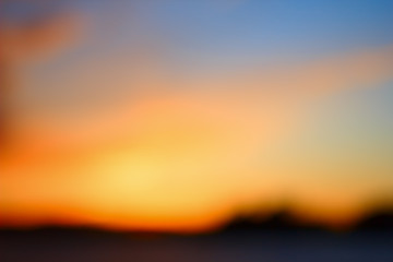 Blurred sunset on the lake