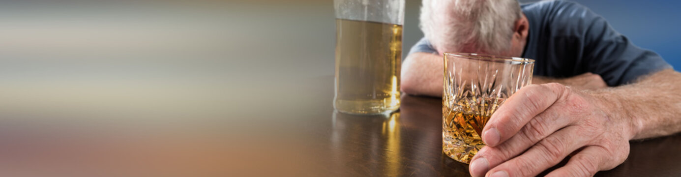 Drunk man sleeping on table after alcohol abuse