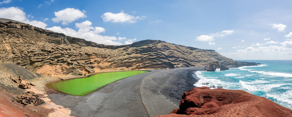 Panorama of Laguna Verde, a green lake near the village of El Golfo in Lanzarote, Canary islands, Spain