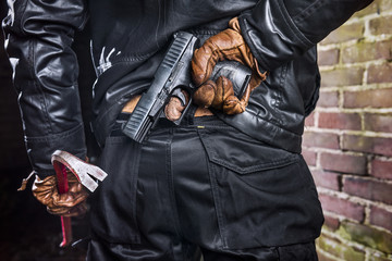 close-up of a criminal with a gun