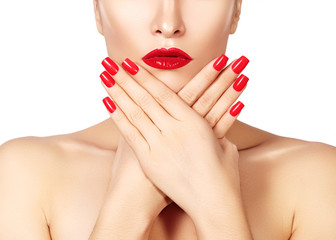 Red lips and bright manicured nails. Sexy open mouth. Beautiful manicure and makeup. Celebrate make up and clean skin