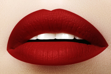 Cosmetics, makeup. Bright lipstick on lips. Closeup of beautiful female mouth with red lip makeup. Part of face