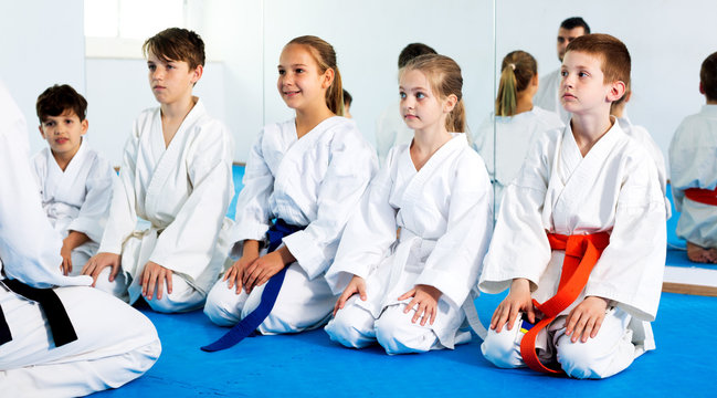 Children enjoying their trainings with coach at karate