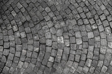 Stone pavement texture. Granite cobble stoned pavement background. Abstract background of old...