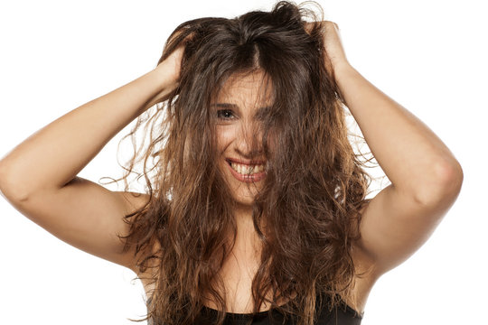 A young nervous woman with a messy long hair