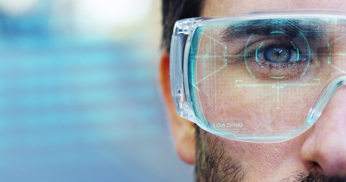 A man with a futuristic look with glasses augmented reality in holography.