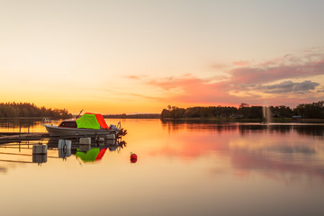 Sunset with boat on a lake near the Swedish town of Ryd