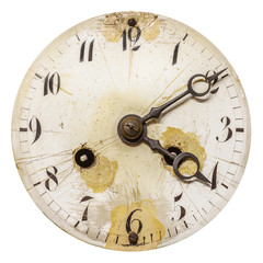 Ancient weathered clock face isolated on white