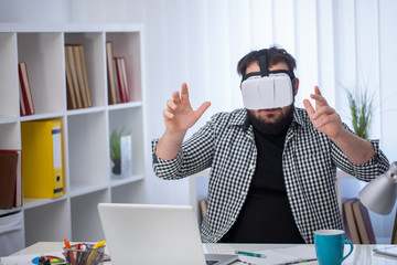 Handsome man exploring virtual reality in office