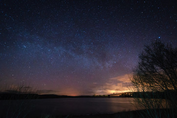 Milky Way above Fontburn Reservoir / Fontburn Reservoir in Northumberland is a popular place for fishing and walking, seen her under the stars at night