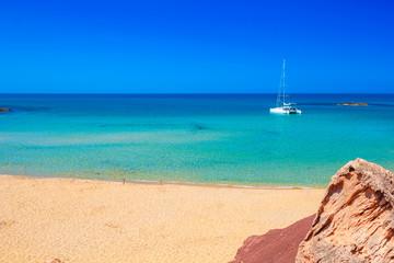 Cala del Pilar beach scenery on sunny summer day at Menorca, Spain.