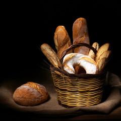 Natura morta con pane e spighe di grano