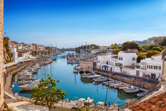 View on old town Ciutadella port on sunny day, Menorca island, Spain.