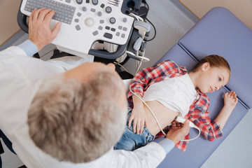 Qualified aging practitioner using ultrasound linear probe at work