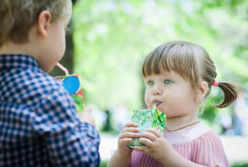 Young children drink juice