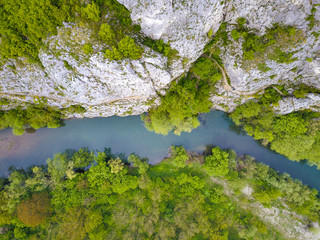Nera River Gorges in Banat, south-western Romania, high up in the mountains. Aerial view top down. Cheile Nerei National Park.