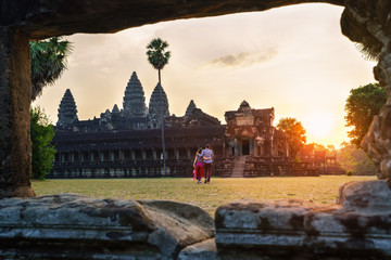Travel couple in Angkor Wat at sunrise moment, Siem Reap, Cambodia Wall mural