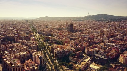 Barcelona cityscape and distant mountains on a sunny day, Spain