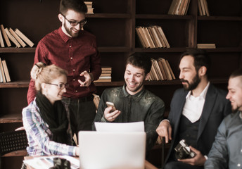 friendly team of copywriters in the workplace in modern office