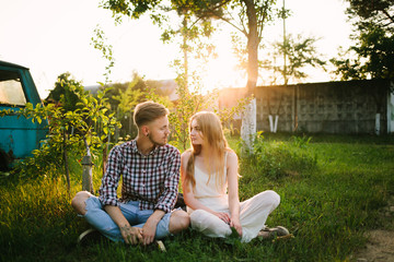 Beautiful Love story in the woods. Portrait of young stylish couple.