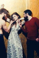Pretty girl and two bearded men with beards