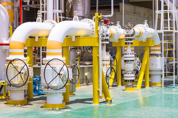 Manual operate ball valve at offshore oil and gas central processing platform.
