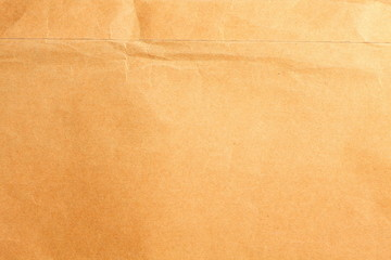 Old and damaged brown color document envelope.