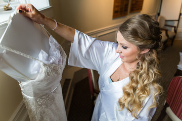 Beautiful woman admiring her wedding dress