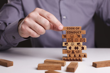 The concept of technology, the Internet and the network. Businessman shows a working model of business: Code of conduct