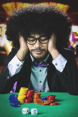 Frustrated Afro man in casino