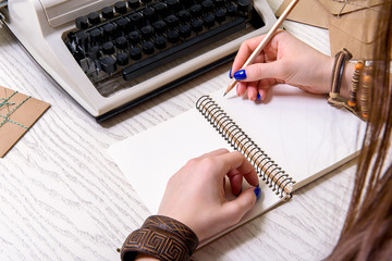 Girl writing on white page