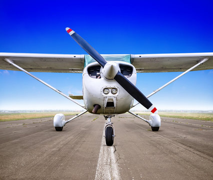 sports plane on a runway