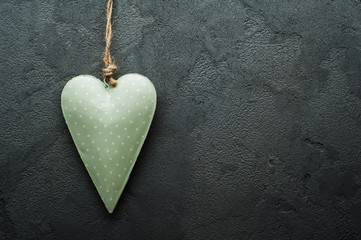 Concrete grey background with green heart