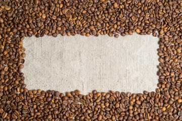Spilled grains of fragrant coffee close-up.