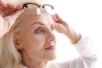 Interested glance of old lady