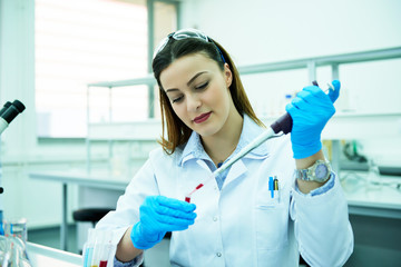 Young beautiful woman at the lab