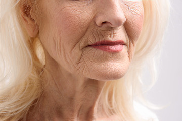 Mature female person with wrinkles